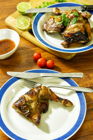 Grilled chicken on table