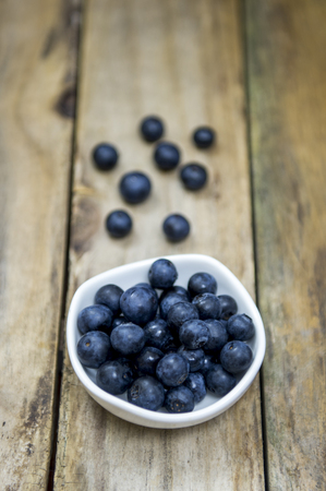 Blueberry with wooden background