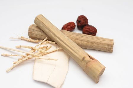 Four different medicinal herbs commonly used in Asia, including dried red dates and sugar cane. Infusions made from such herbs have been used to cure and prevent many health ailments including sore throats and swollen lymph nodes. Stock Photo - 4819929