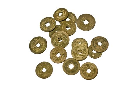 Scattered copper coins. The disc-shape with a square hole in the middle is typical of ancient Chinese currencies. Chinese characters are also visible on the surface of some coins. Stock Photo - 5046739