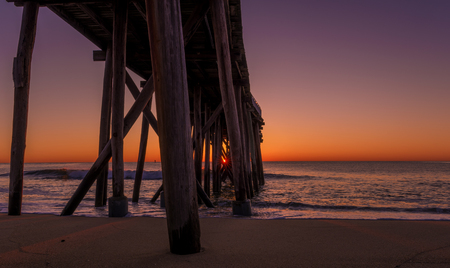 Beautiful view of Belmar fishing pier located in New Jersey at sunrise. Stok Fotoğraf