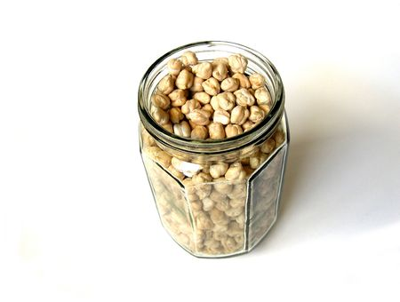 Chick Peas in Big Bottle on a White Background           Stock Photo