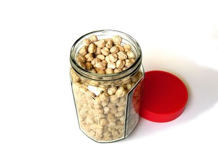 Chick Peas in Bottle with Red Cap on a White Background           Stock Photo