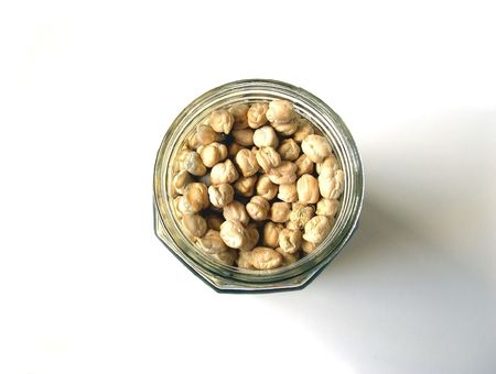 Chick Peas in Bottle Top View on a White Background