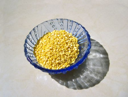 Yellow moong dal, a pulse, in blue bowl