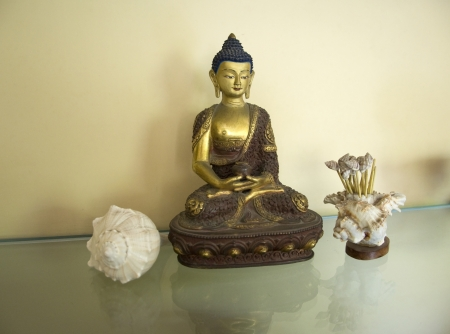 A beautiful statue of Amitabha Buddha sitting on a Lotus Base Stock Photo - 15735010