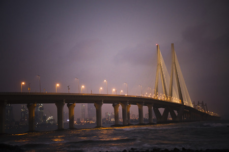 dramatic: A Dramatic, Enchanting, Beautiful Night View of Bandra-Worli Sea Link from Bandra Fort. Stock Photo