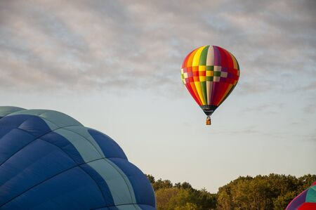 Beautiful Colorful Hot Air Balloon flying in the Tranquil sky - Thirty Four