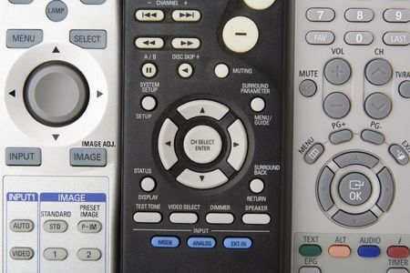 remote controls: Three remote controls with round buttons Stock Photo