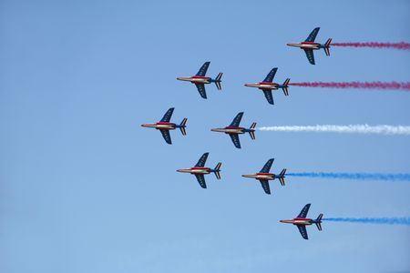 national colors: Formation of jets paints French national colors in the sky Stock Photo