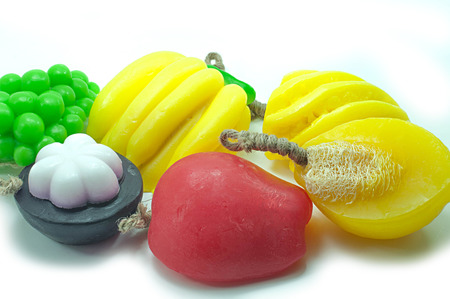 Natural handmade soaps, fancy fruit on a white background. photo