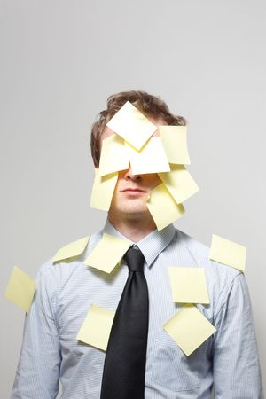 Man covered in yellow notes photo