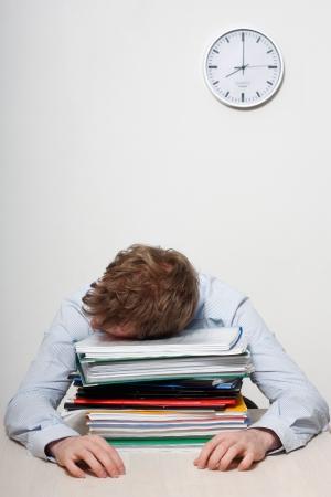 sleeping at desk: A tired business man sleeping