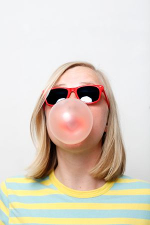A girl playing with her chewing gum