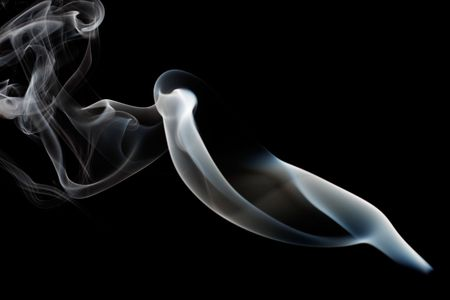 Abstract smoke curling and creating beautiful shapes photo