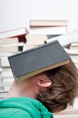 A man sleeping behind a book photo