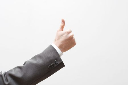 signalling: A business man signalling thumbs up Stock Photo