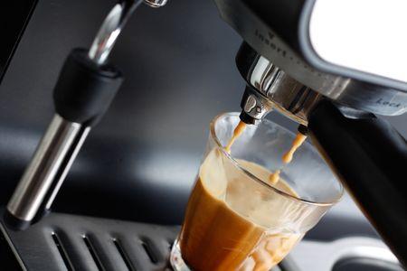 Espresso machine brewing a coffee espresso photo