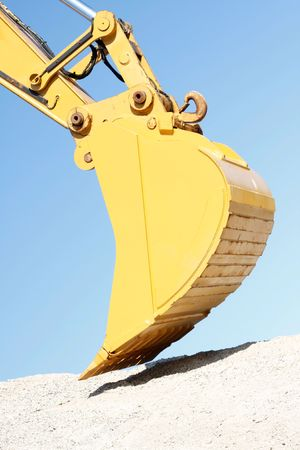 A huge shovel digging in dirt Stock Photo - 5367020