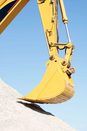 back hoe: A huge shovel digging in dirt