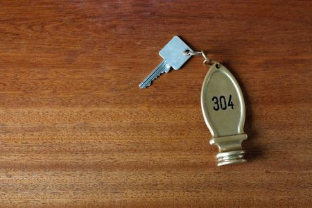 A hotel key on a table Stock Photo