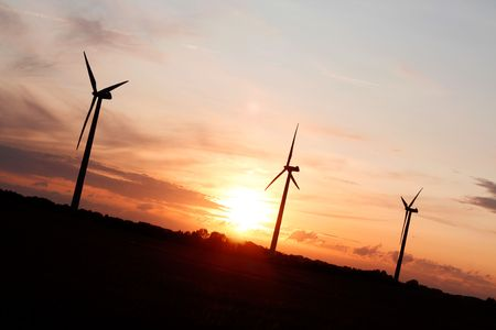 Windmills showing renewable energy in the evening photo