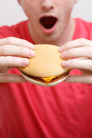 A man eating a burger Stock Photo - 5366415