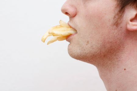 boasting: A man full of fries Stock Photo