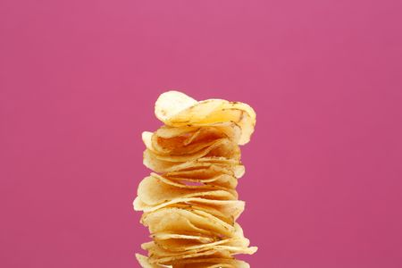 chips stack: Stack of potato chips Stock Photo