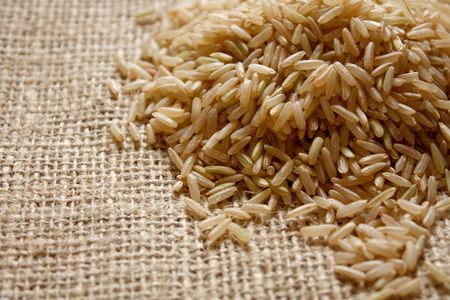 brown rice: Brown rice on a textile background