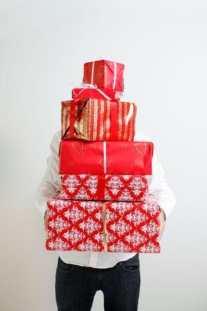 A man presenting several christmas presents Stock Photo - 5565173