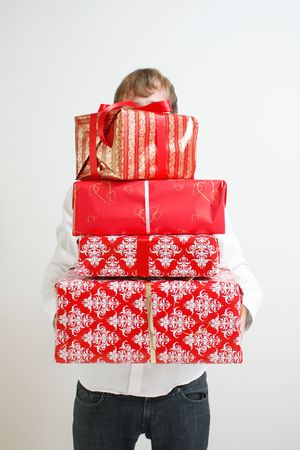 A man presenting several christmas presents Stock Photo - 5565190