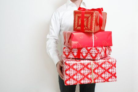 A man presenting several christmas presents photo