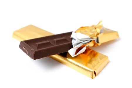 A dark chocolate bar on white photo