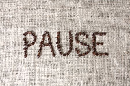 spelled: Pause spelled by coffee beans