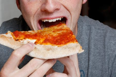 Man eating a pizza slice Stock Photo