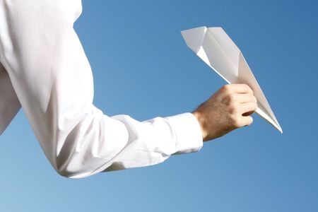 A business man throwing a paper plane photo