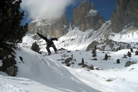 A freestyle snowboarder jumping in the alps photo