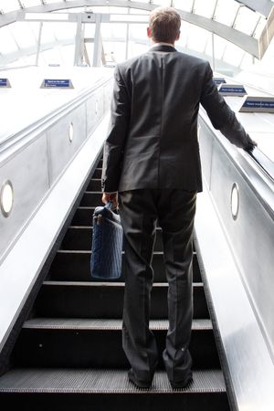 commuting: A business man commuting in  suit Stock Photo