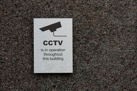 stating: A cctv sign stating that there is cctv in the area