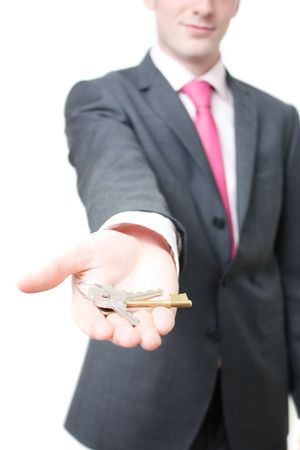 A business man giving you the keys to a home photo
