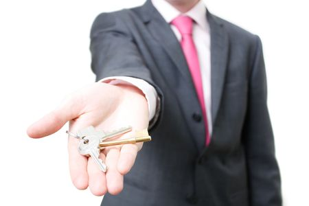 letting: A business man giving you the keys to a home Stock Photo