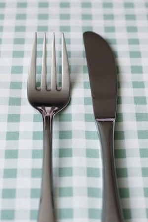 fork in path: Fork and knife Stock Photo