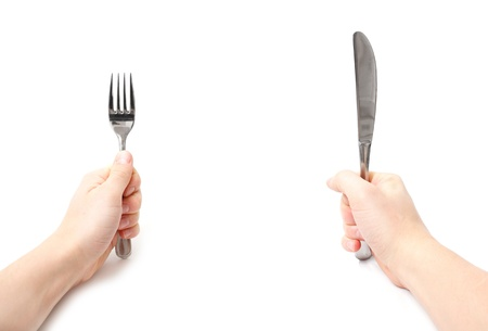 Hands holding knife and fork photo