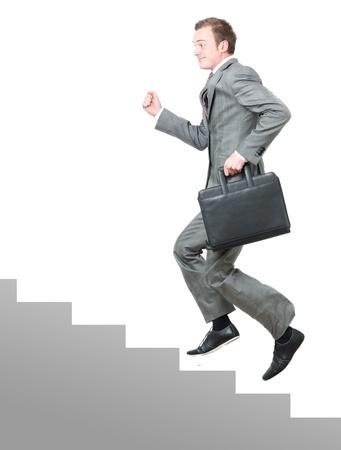 subiendo escaleras: Escalera corporativa Foto de archivo