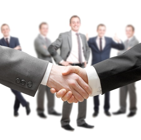 Businessmen in a group and a handshake photo