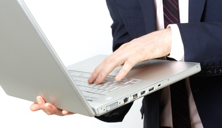 Business man with laptop typing photo