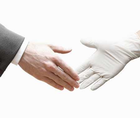 A doctor shaking hands with a business man photo
