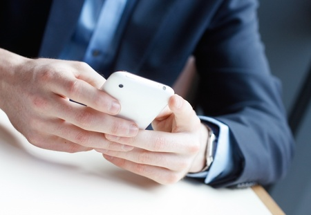 sms text: Businessman on phone Stock Photo