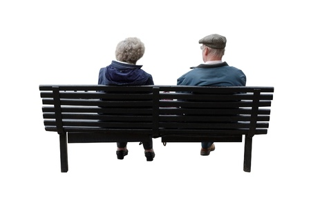 bench: A senior couple sitting on a bench